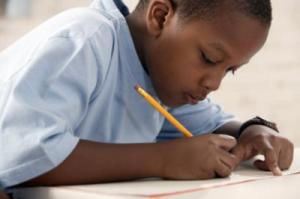 black child writing